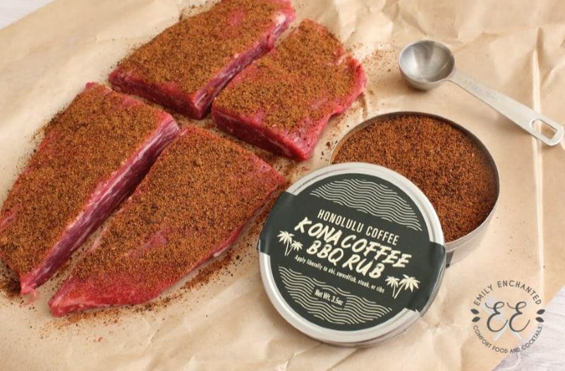 Open tin of Honolulu Coffee Kona Coffee BBQ Rub with flank steak and measuring spoon