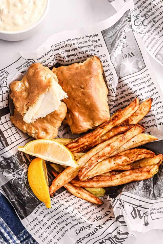Air Fried Halibut and Homemade Steak Fries with lemon wedges