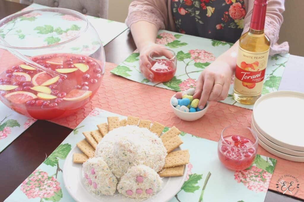 Easter table setting with pink punch and bunny butt cheese ball dessert