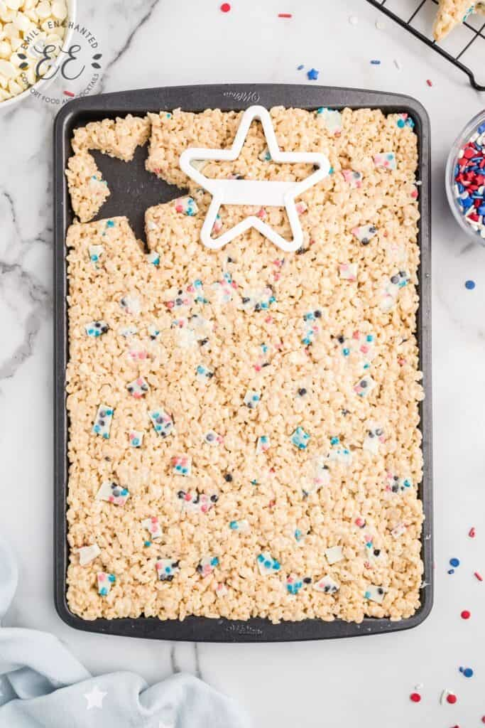 Rice krispie treats in pan cut with a star shaped cookie cutter