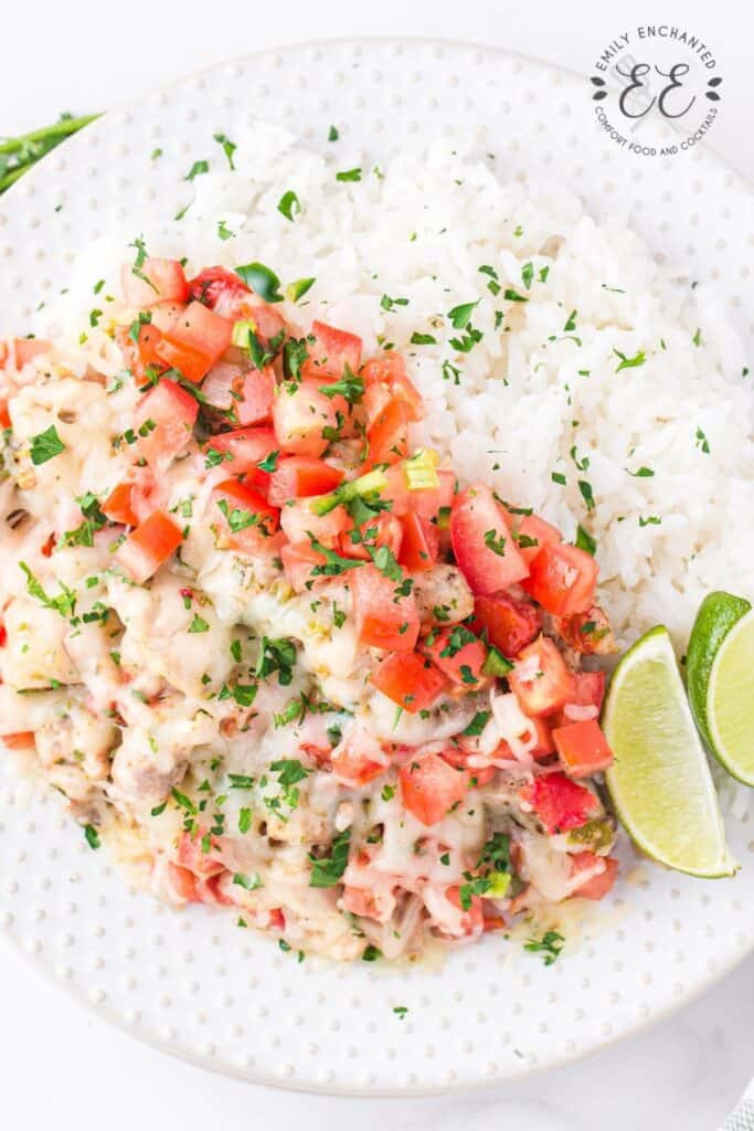 Salsa Chicken Recipe on a plate with rice and lime wedges