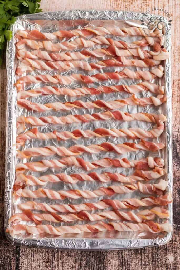 Twisted Strips of Bacon on a Baking Sheet